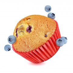 Muffin flying with blueberries isolated on white