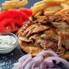 Greek gyros dish on a black dish